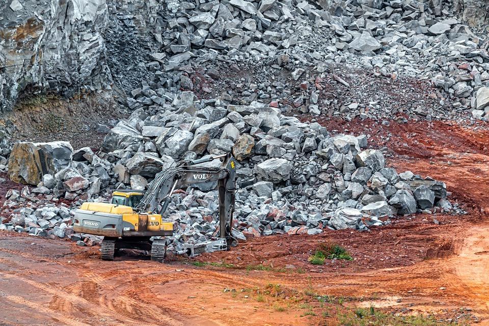 Excavator in mining site